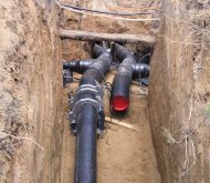 Welding of plastic water conduit in excavation
